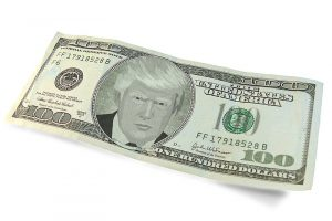 A $100 bill with Trump's likeness in the center.