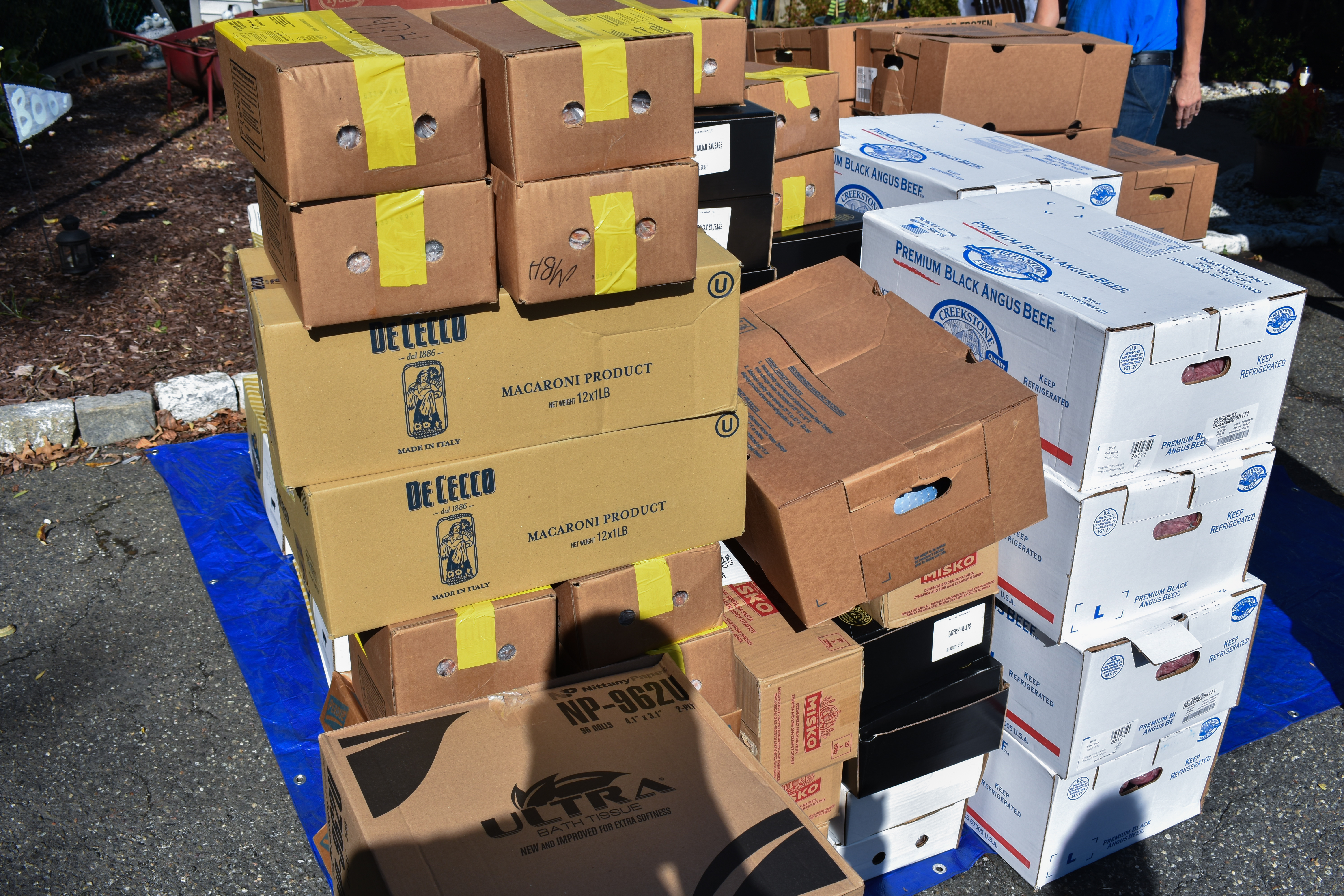Boxes of donated food; image courtesy of Bertone Piccini and MBH Foods.