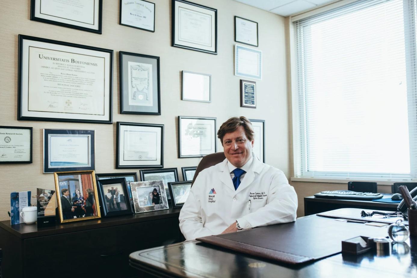 Doctor seated at desk; image by LinkedIn Sales Navigator, via Pexels.com.