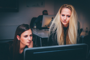 Two women looking at computer monitor; image by Free-Photos, via Pixabay.com.