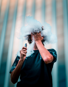 Man vaping with heavy clouds of vapor; image by Nathan Salt, via Pexels.com.