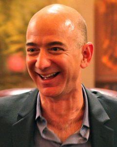 A grinning bald man.