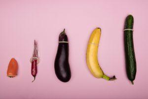 Various fruits and vegetables wearing condoms; image by Deon Black, via Unsplash.com.