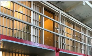 Corrections Officer Kicked Fully Restrained Inmate in the Face