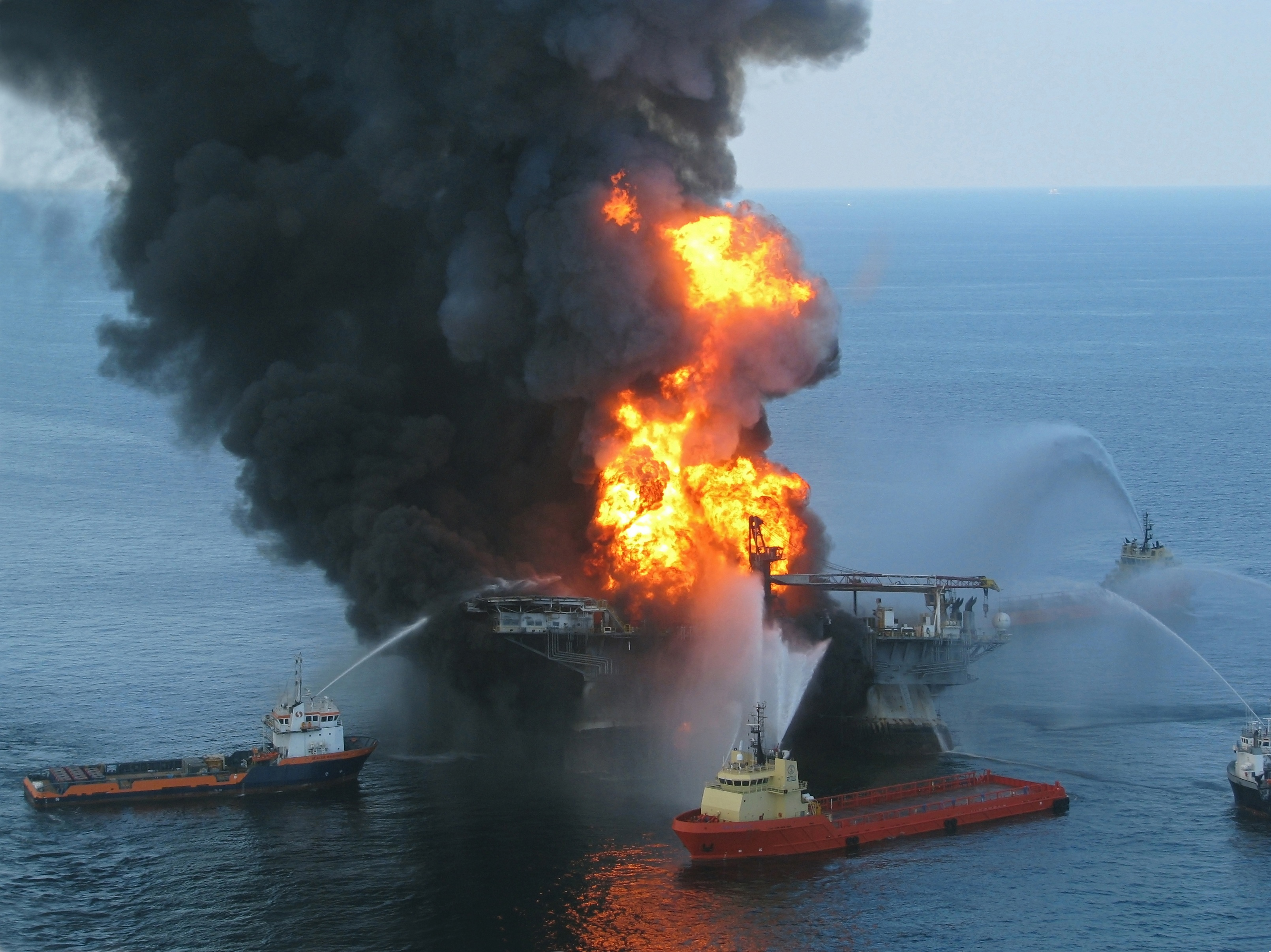 Flames and thick smoke erupt from the Deepwater Horizon oil rig.