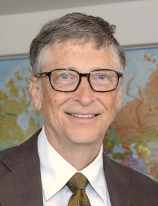 A middle-aged man in glasses and a suit.