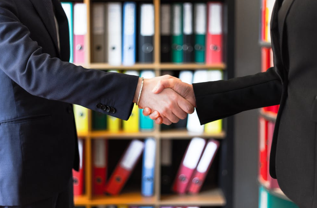 Two people shaking hands; image by Oleg Magni, via Pexels.com.