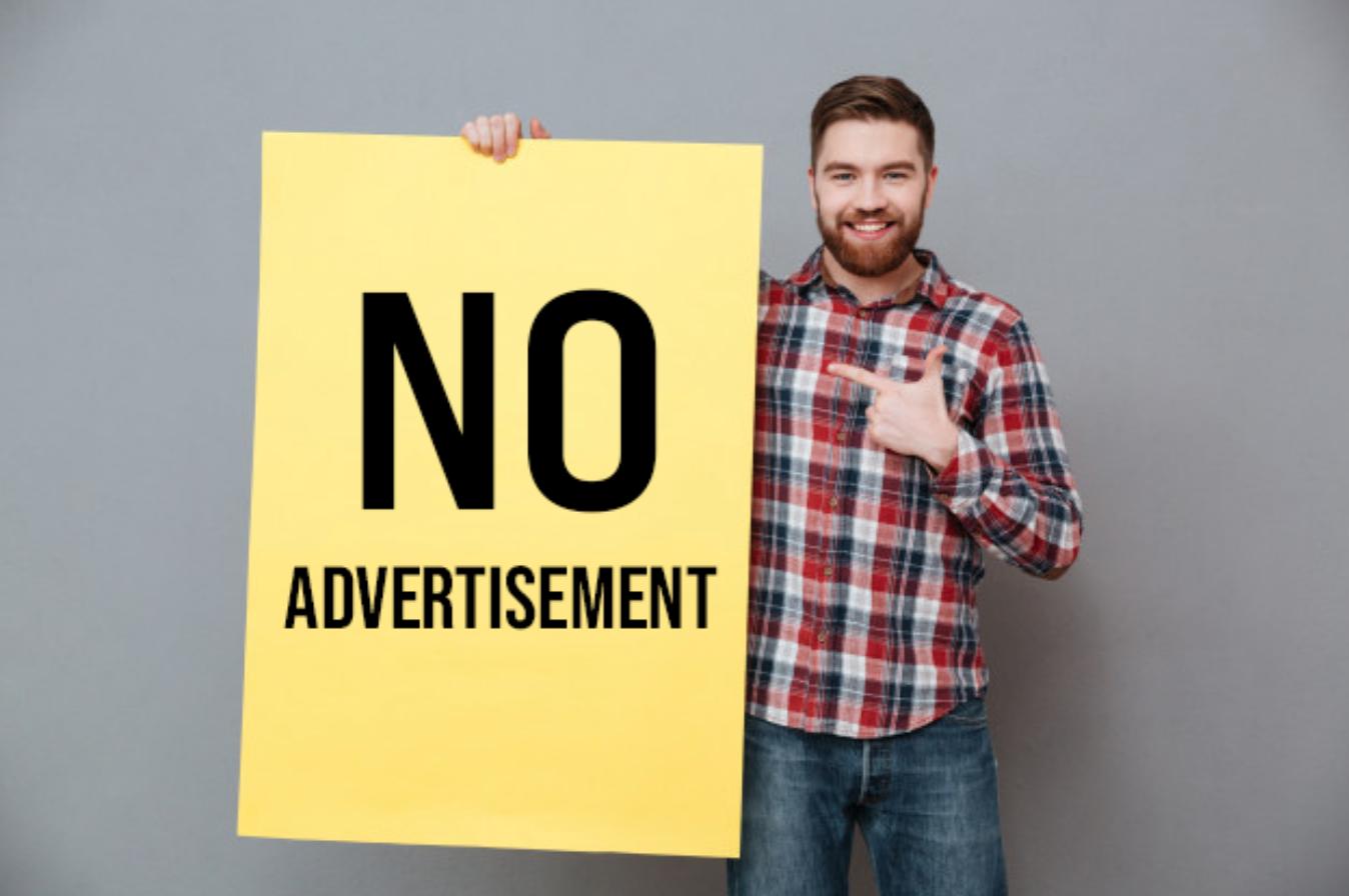 "Man holding sign that says ""No advertisement."" Image by drobotdean, via Freepik.com."