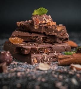 Stacked pieces of chocolate; image by Pushpak Dsilva, via Unsplash.com.