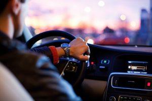 Man driving car; image by Why Kei, via Unsplash.com.