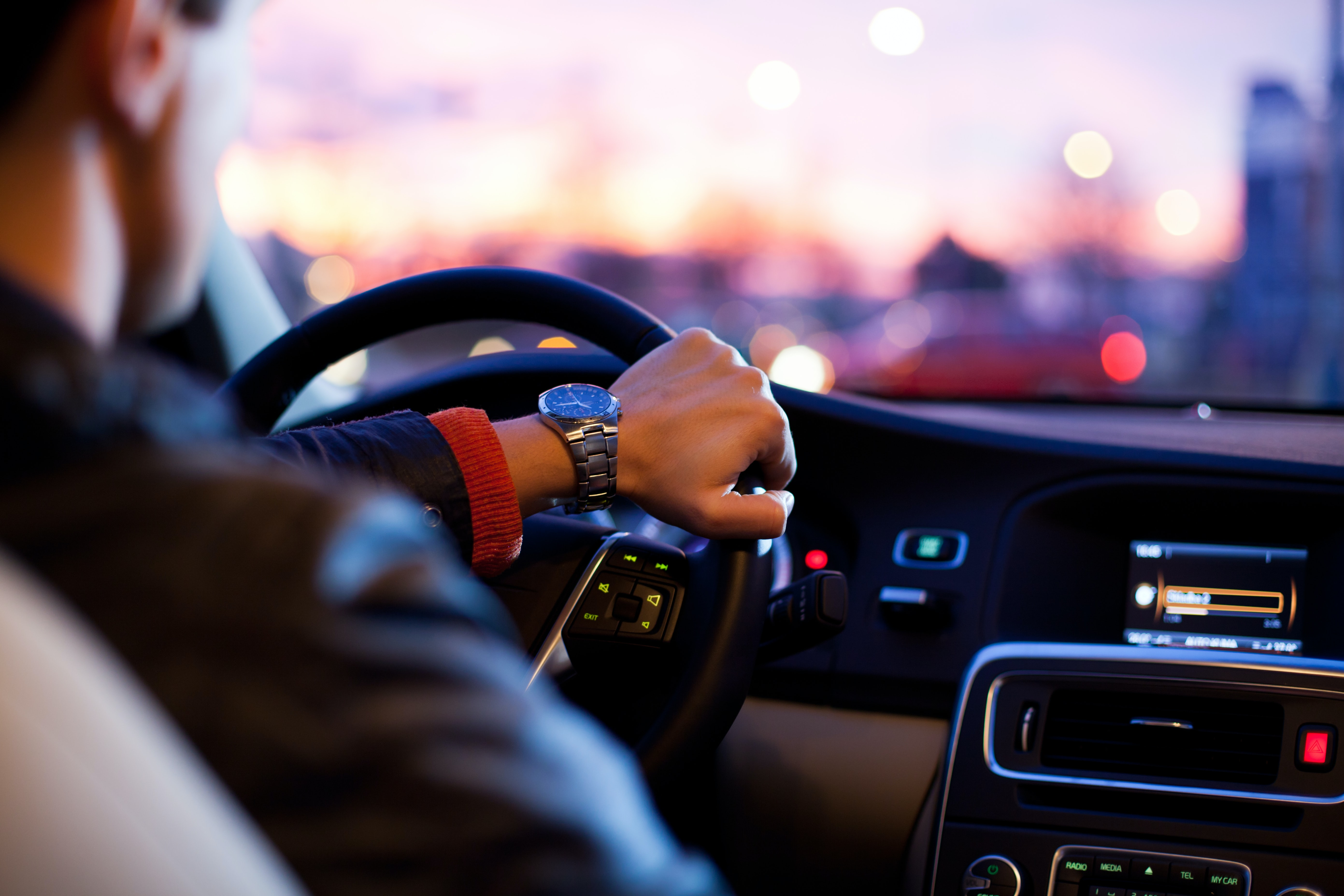Man driving car; image by Why Kei, via Unsplash.com.