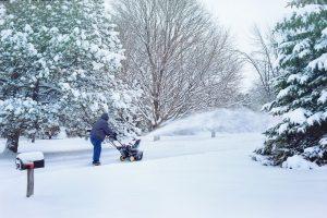 Person snowblowing