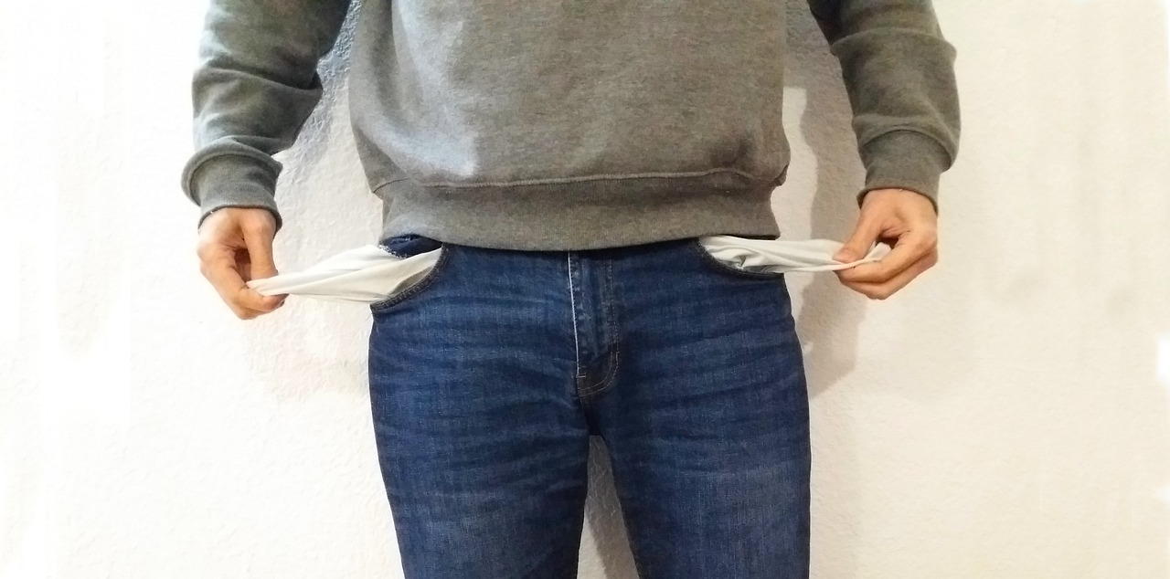 Person with empty pockets