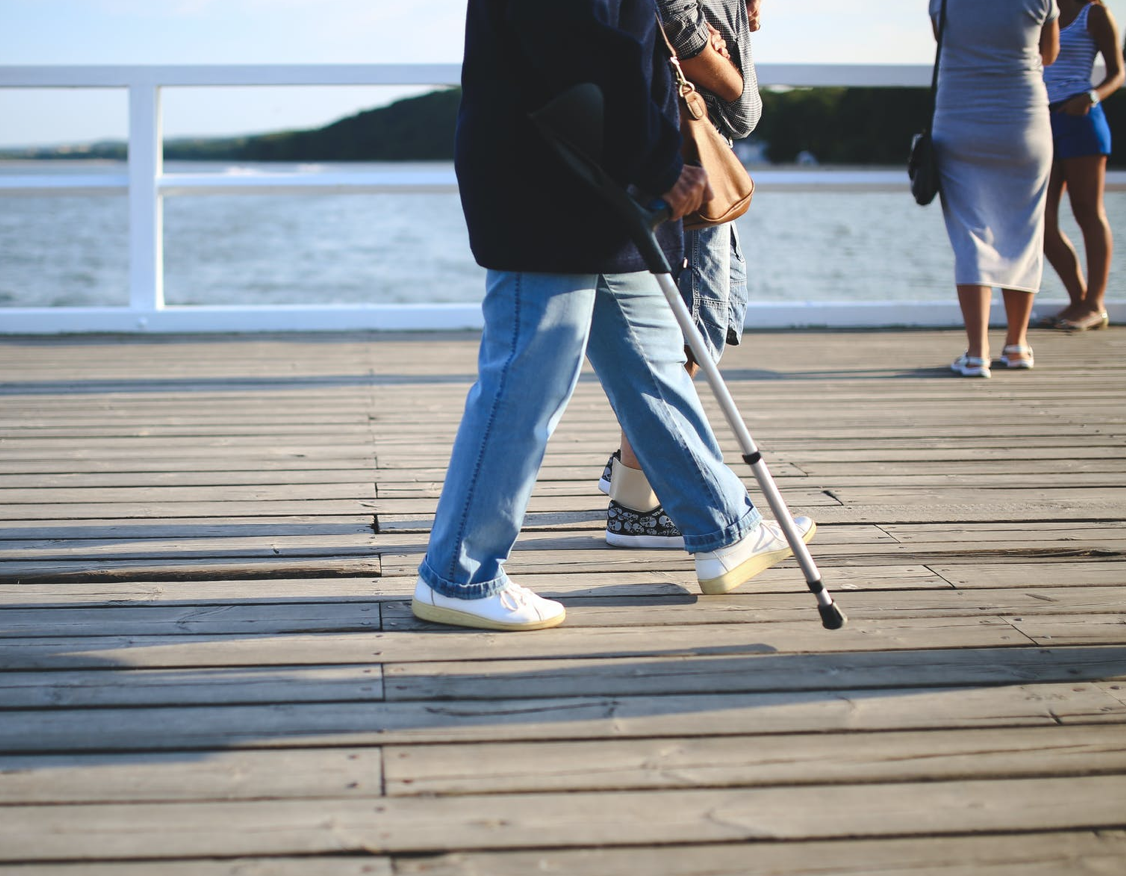 An afternoon stroll with a cane. Image courtesy of Kaboompics via pexels.com.